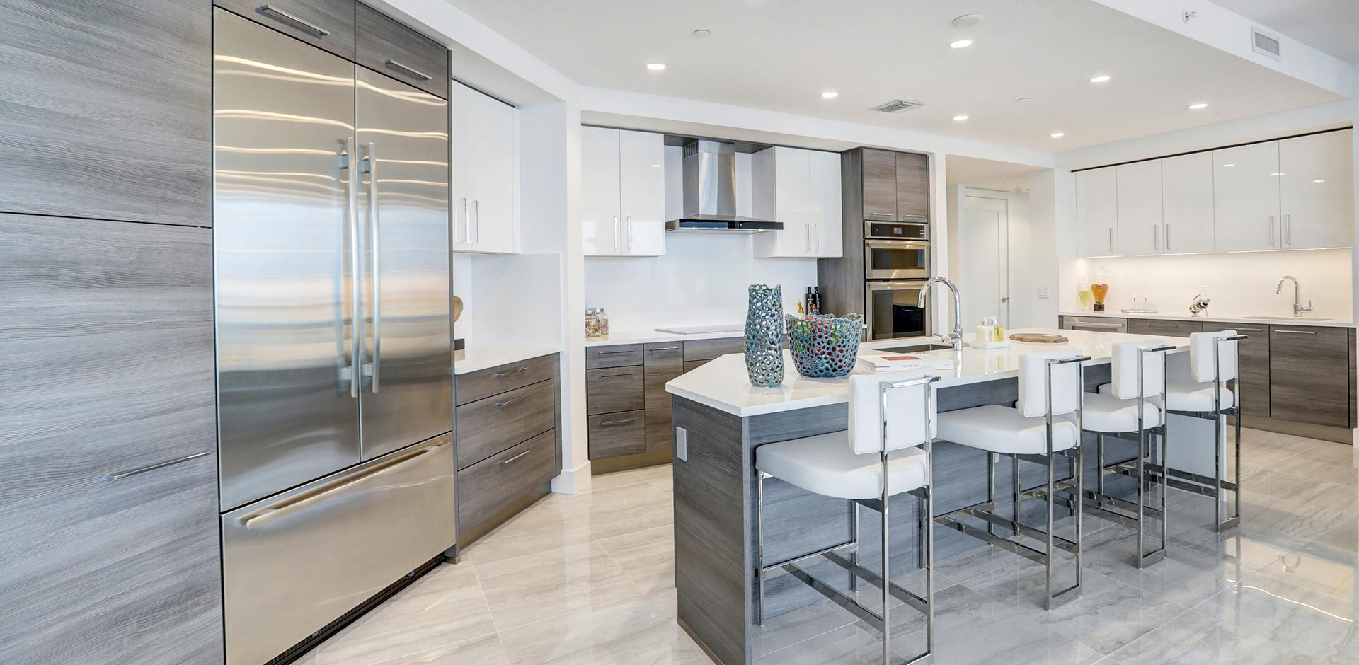 grey modern kitchen with island at 100 las olas residence